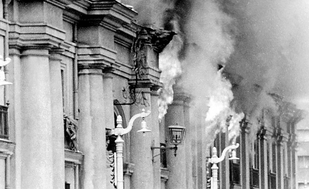 FILE--Smoke pours from the Chilean presidential palace, La Moneda, in this Sept. 11, 1973, file photo, after being hit by rockets fired by the air force Hawker Hunter jet fighters. Tuesday, Sept. 11, 2001, marks the anniversary of the military coup led by Gen. Augusto Pinochet overthrowing Marxist President Salvador Allende, who committed suicide before he could be captured in the coup. (AP Photo/Alberto Bravo, File)